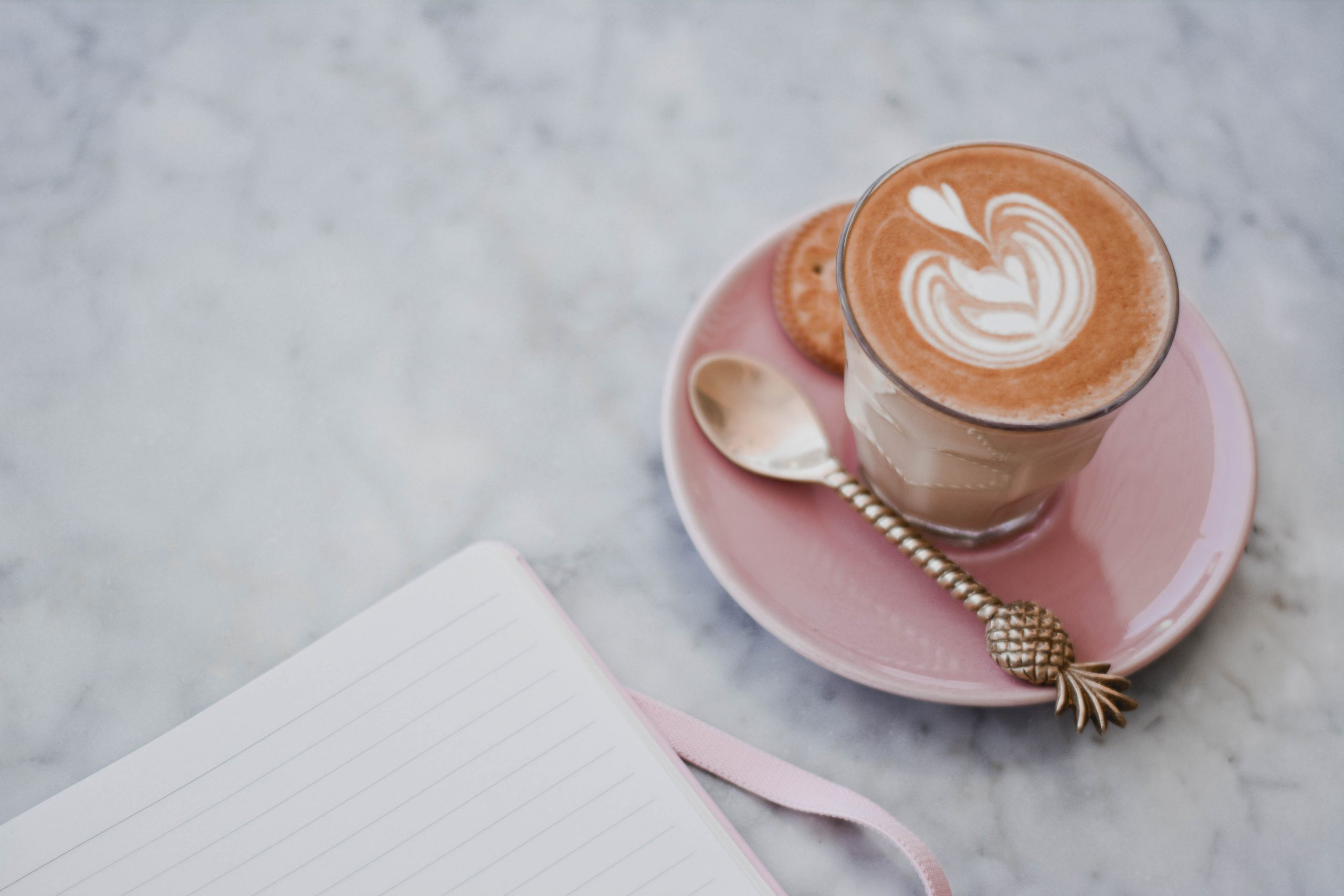 A morning coffee and a journal by Content Pixie
