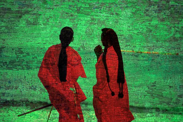 Women in red with green background